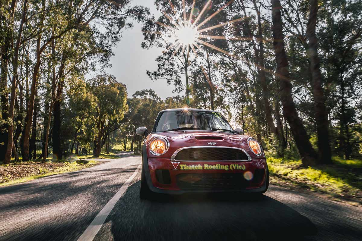 2008 JCW Mini Cooper S driving through forest