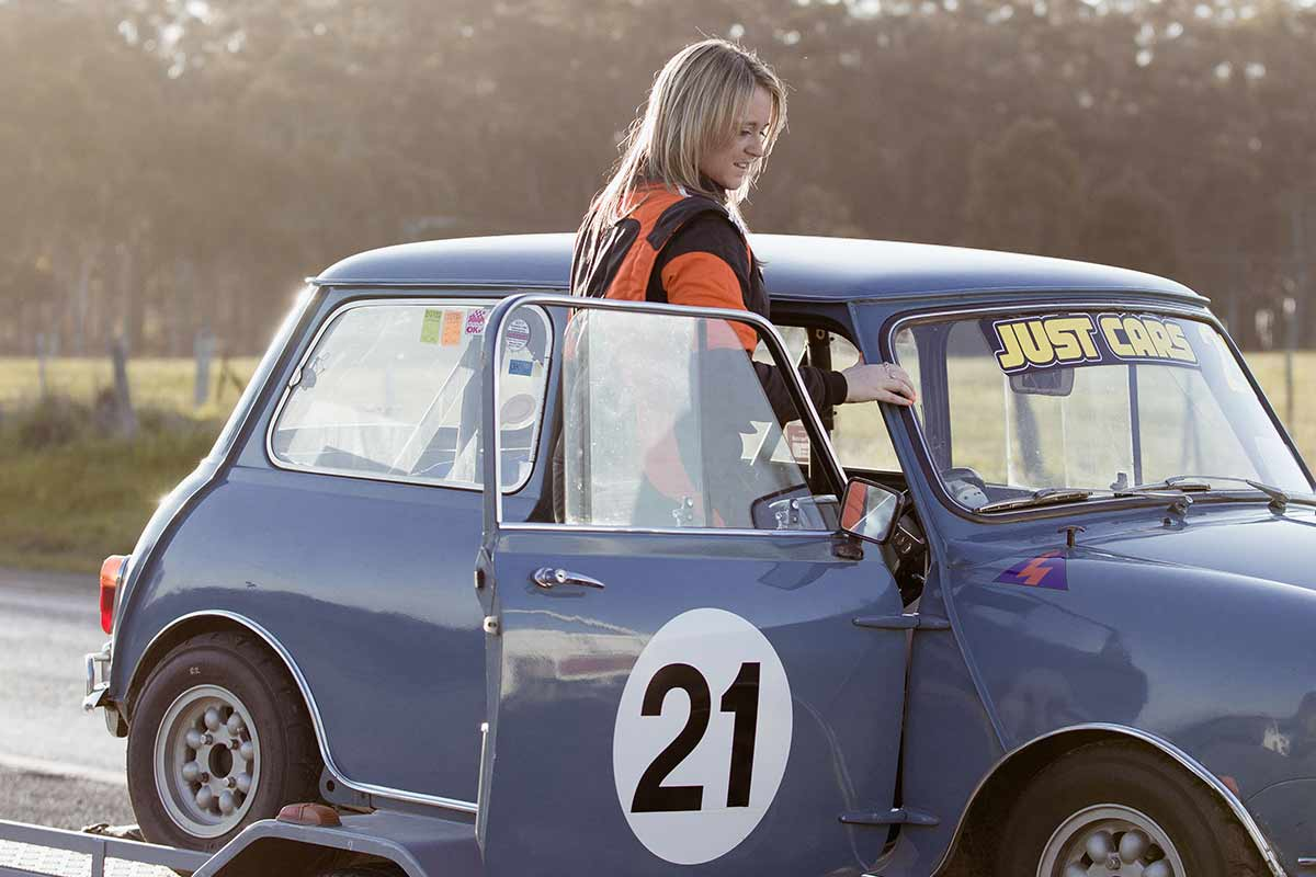 Linda Devlin entering her 1964 Mini Cooper S